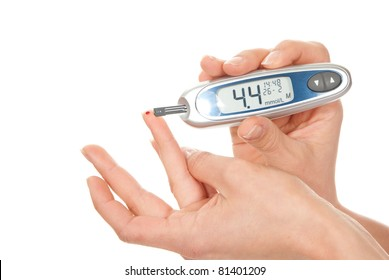 Diabetes patient measuring glucose level blood test using ultra mini glucometer and small drop of blood from finger and test strips