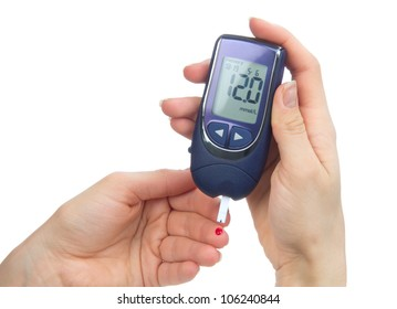Diabetes patient poked finger to measure a glucose blood level test by new smart glucometer isolated on a white background