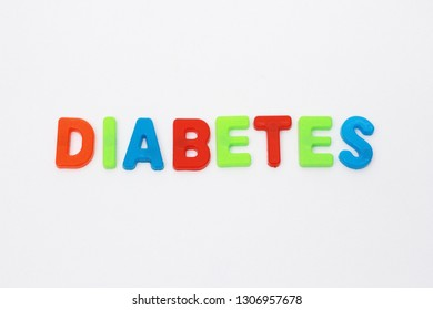 """""""DIABETES"""" Word spelled out in plastic colorful alphabet on white background."""