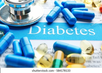 DIABETES word with stethoscope and pills, closeup