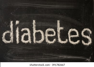Diabetes word written with sugar on blackboard