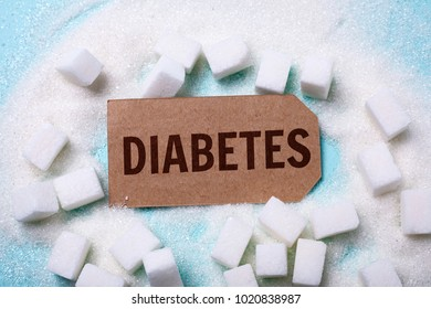 DIABETES words on a green background with a bunch of sugar