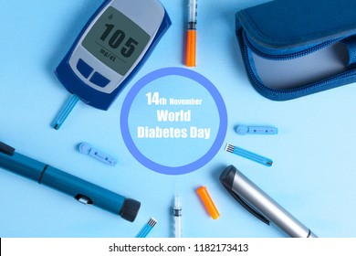 Diabetes. World Diabetes Day, 14 November. Diabetes concept. Glucose meter, injections for insulin and pen syringe on a blue background. Diabetic supplies