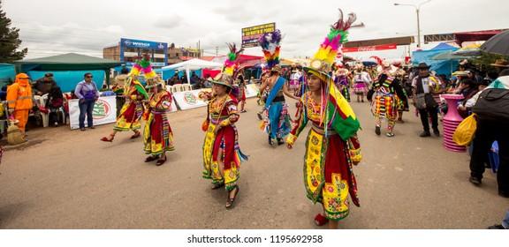 Diablada, Caporal, Morenada & Tinkus  Dancers at Juliaca Carnival Celebration - Puno, Juliaca Perú. March 05, 2017