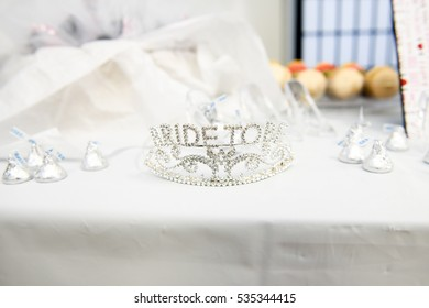 Diadem with lettering 'Bride Tobe' stands on white table