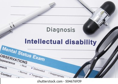 Diagnosis Intellectual Disability. Medical note surrounded by neurologic hammer, mental status exam with an inscription in large letters psychiatric diagnosis of Intellectual Disability