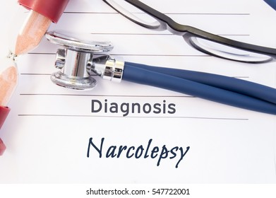 Diagnosis Narcolepsy. Psychiatric diagnosis Narcolepsy is written on paper, on which lay stethoscope and hourglass for measuring time to research. Concept photo for psychiatry or psychology
