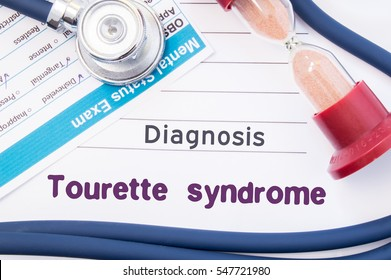 Diagnosis of Tourette syndrome. On psychiatrist or psychologist table is paper with inscription Tourette syndrome (disease) near psychiatric report, hourglass and stethoscope