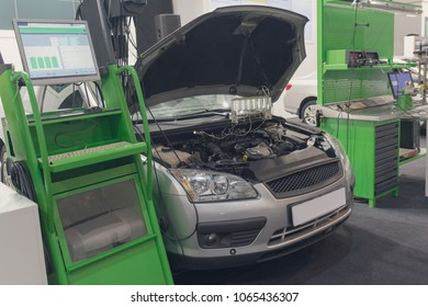 Diagnostic equipment and a car in a car service. Industry