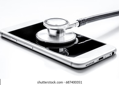 diagnostic of gadgets on white background with stethoscope