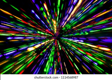 Diagonal blurred lines of color lights is converged on dark background. Colorful lights blurred by motion.