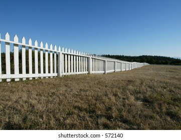 diagonal fence with blue sky