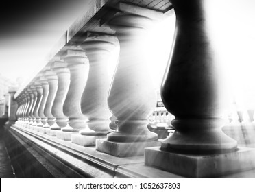 Diagonal light leak whrough black and white columns background