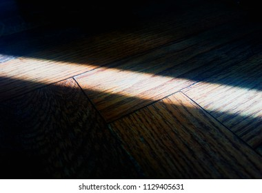 Diagonal light ray on floor texture background