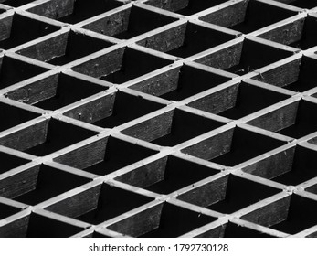 diagonal patterned steel grate black and whie