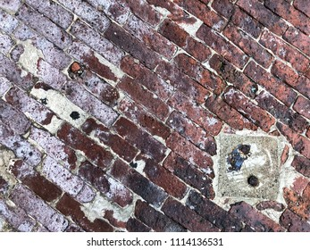 Diagonal red bricks, cement, white and yellow paint, and rusty metal textured background with copy space.