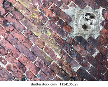 Diagonal red bricks, cement, yellow paint, and rusty metal textured background with copy space.