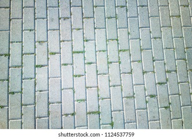 Diagonal tiles with grass texture background