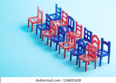 diagonally installed chairs in two rows, blue and red color, plastic toy chairs