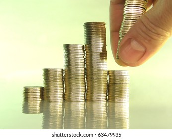 diagram consisting of piles of coins, denotes the artificial creation of the financial crisis