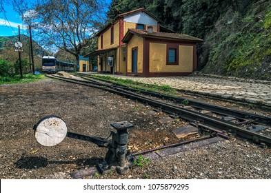 Diakofto - Kalavrita route Odontotos rack railway. Mega Spileon train station at Zachlorou village, Peloponnese, Greece. Sunny day, blue sky