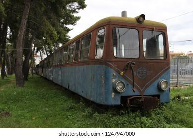 Diakopto, Aigialeia / Greece - 12/02/2018: Abandoned old rusty train of odontotos at Diakopto to Kalavryta train station on railway full of grass and weeds