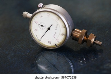 dial gauge on the background and use in inspection job, dial gauge is special tools for check and inspection some machine equipment to check clearance or gamage surface, industry tool for inspector.