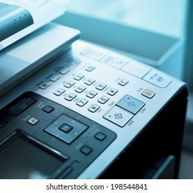 Dial Pad on a fax machine with blue lights