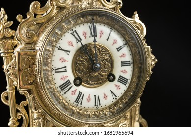 dial of vintage bronze clock, antique clock photo close up, old bronze clock in gilding, eleven o'clock on the dial, 11 am on the clock face, 11 pm hours on the dial