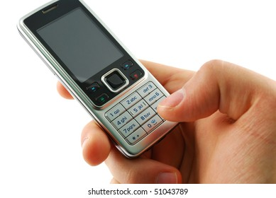 Dialing a mobile phone on a white background.