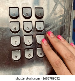 dialing a number using a public phone