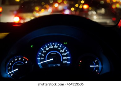dial-mile car - front view of traffic jam and driving at night