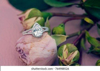 Diamon engagement ring on natural romantic background