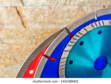 Diamond blades for granite, reinforced concrete and stone against a background of orange-gold sandstone walls.