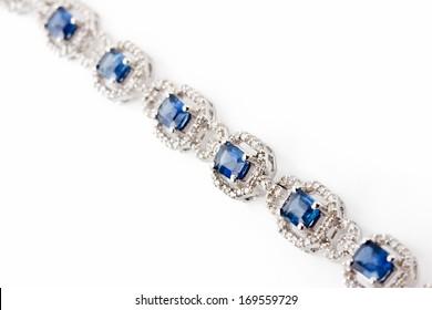 Diamond bracelet with many blue stones on white background