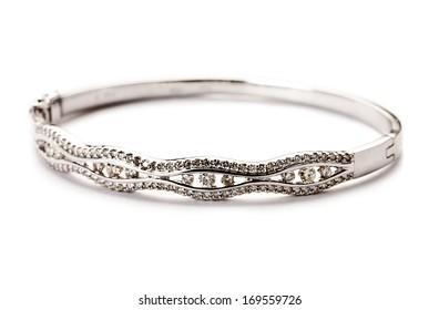 Diamond bracelet with many stones on reflective background