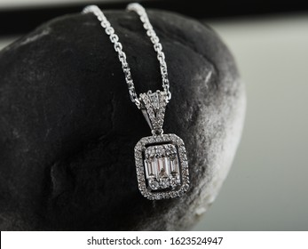 Diamond chain necklace on black stone background