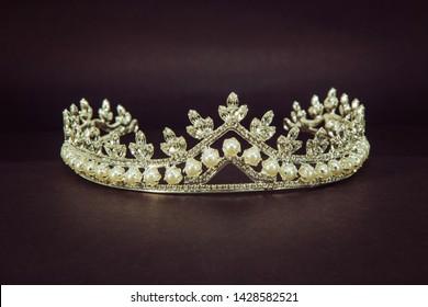 diamond crown for brides in close up on dark background,