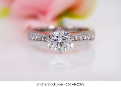diamond engagement ring on abstract color background