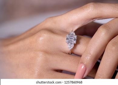 Diamond engagement ring on hand