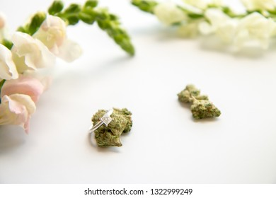 Diamond Engagement Ring on Marijuana Bud White Floral Cannabis Flowers - Cannabis Wedding