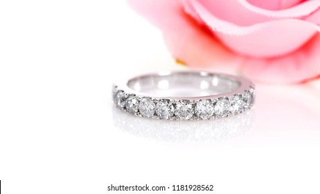 Diamond eternity ring with Flower background