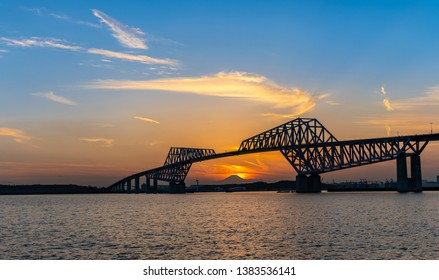 Diamond Fuji in Tokyo with Tokyo Gate Bridge, natural phenomenons that sun move pass mountain Fuji while sunset in Tokyo Japan. This happen only 2 times once a year.