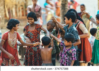 DIAMOND HARBOR, INDIA - APRIL 05, 2013: Rural indian children in colorful clothes playing and dancing