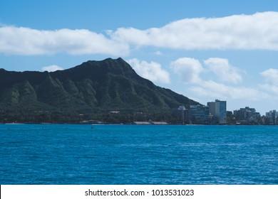 Diamond Head Honolulu Waikiki Hawaii from a boat with clear blue skies