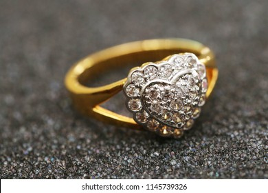 Diamond heart symbol on gold ring
