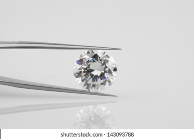 Diamond held within diamond tweezers.