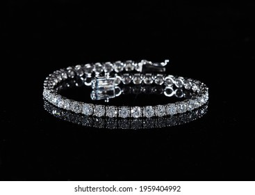 Diamond jewelry. Diamond bracelet on black background