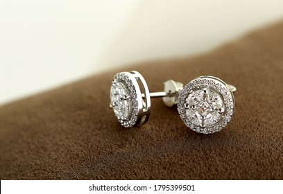 Diamond jewelry. Diamond earrings on brown velvet