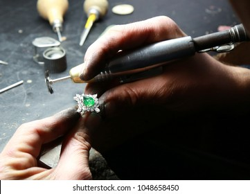 diamond making a ring' s wax mold, jewelry making witgold smith making a ring' s wax mold, jewelry making emaraland  and diamond ring